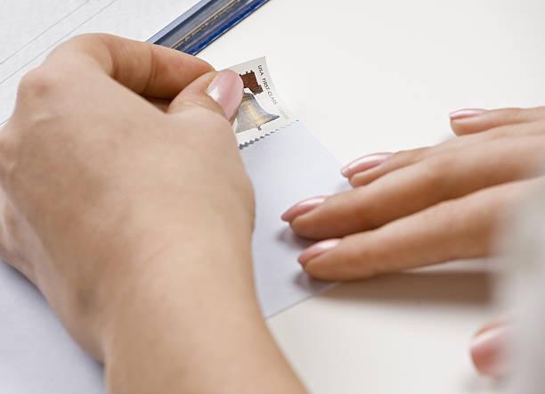 Woman addressing envelope stock photo