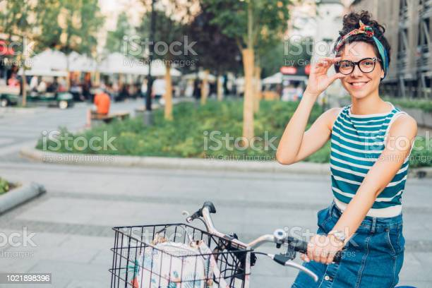 Woman adjusting eyeglasses while sitting on a bicycle picture id1021898396?b=1&k=6&m=1021898396&s=612x612&h=6rghhktw ejioa 7rszx51pyjnljv7ihjoqhx31l97i=