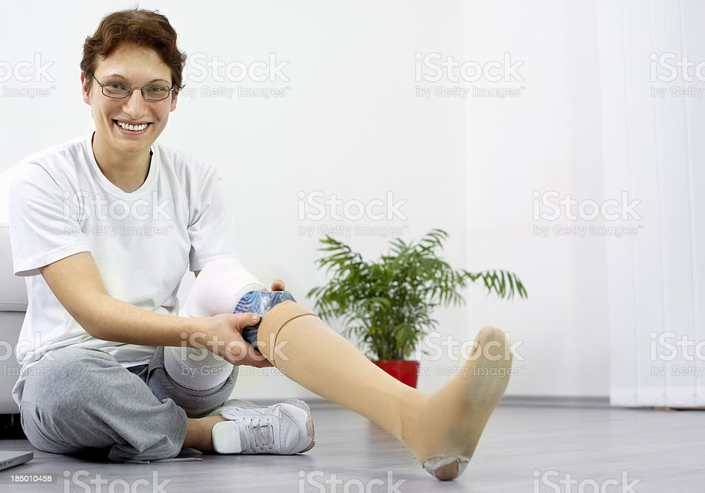 Woman Adjusting Her Artificial Limb stock photo