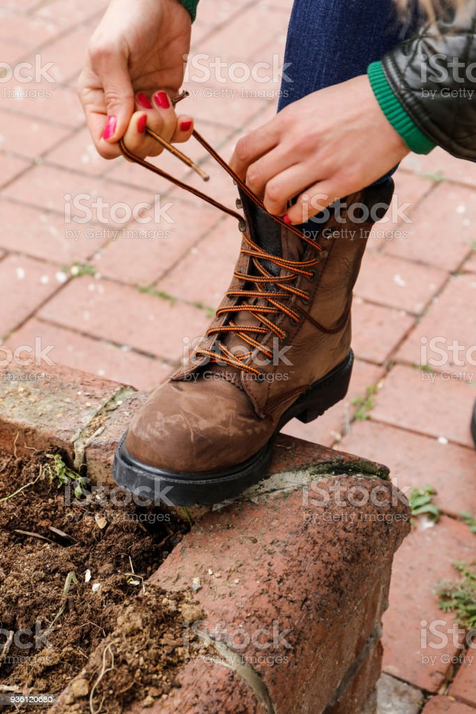 Woman adjusting shoes stock photo