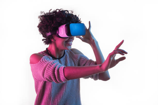 Woman adjusting VR headset and touching air stock photo