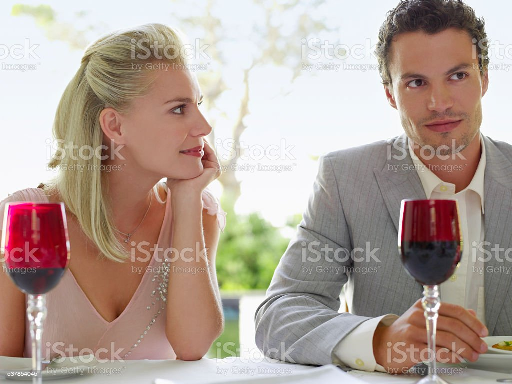Woman Admiring Man At Dinner Table stock photo