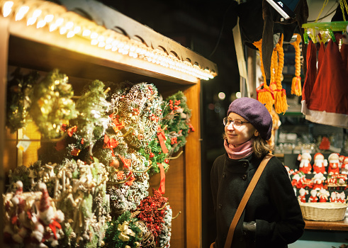 Woman admiring the best Christmas market wreath
