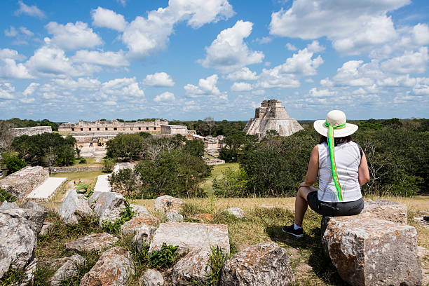 woman admiring the mayan ruins of uxmal, yucatan, mexico-xxxl - uxmal stock photos and pictures