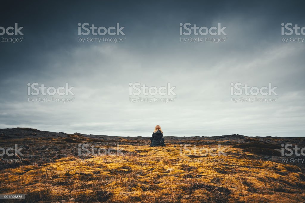 Woman Admiring The Volcanic Landscape In Iceland stock photo