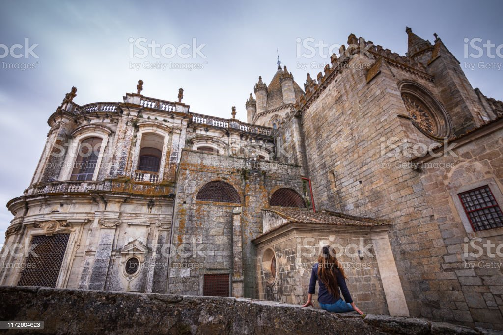Woman admiring view of medieval Cathedral of Évora, Portugal - Royalty-free 40-49 Years Stock Photo