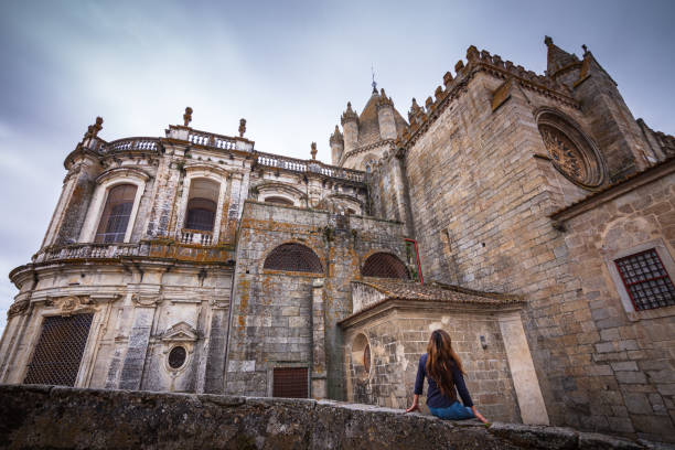 Woman admiring view of medieval Cathedral of Évora, Portugal stock photo