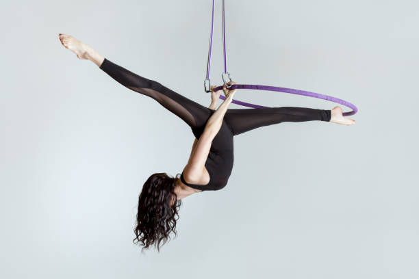 Woman aerial acrobat on the ring. stock photo