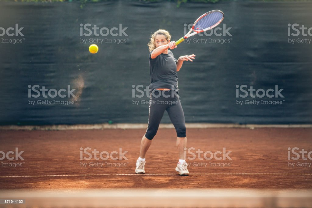 Woman After Hitting the Ball stock photo
