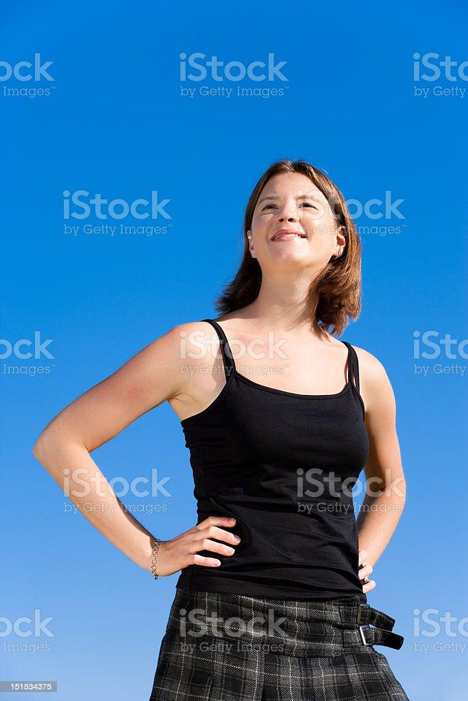 Woman against Blue Sky stock photo