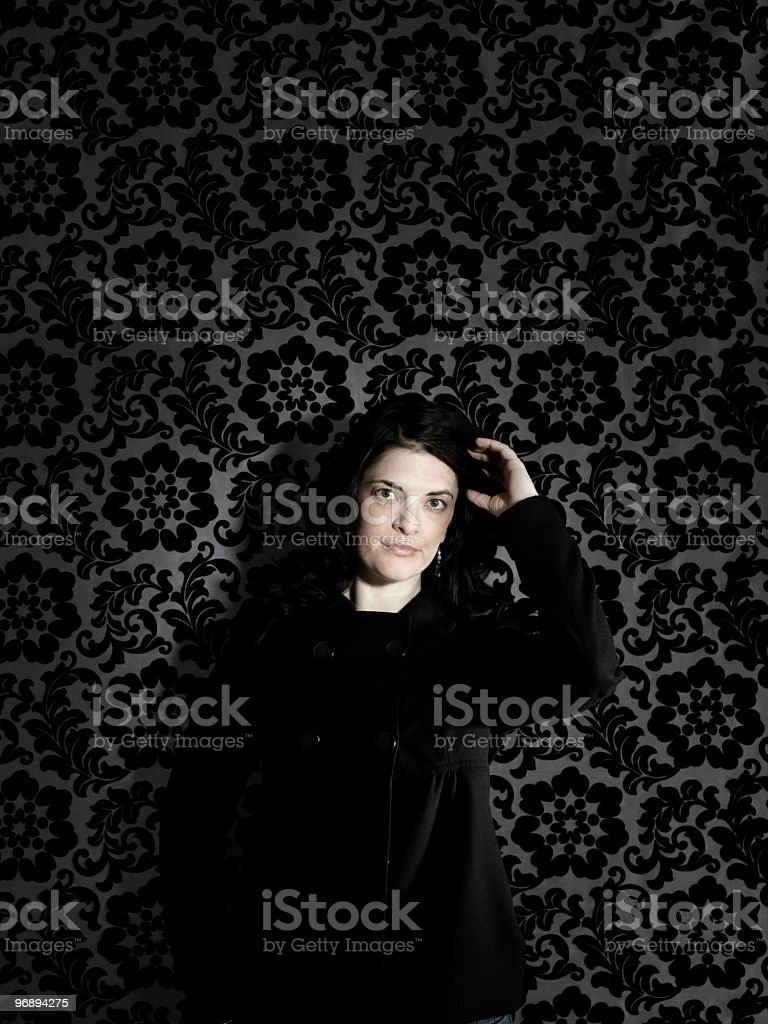 Woman Against Funky Wall royalty-free stock photo