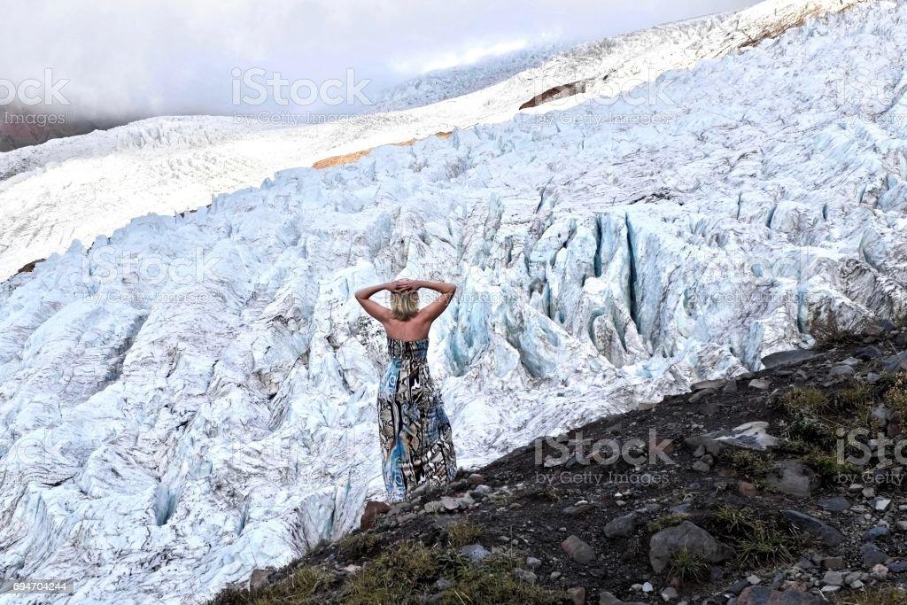 Woman against glacier. stock photo
