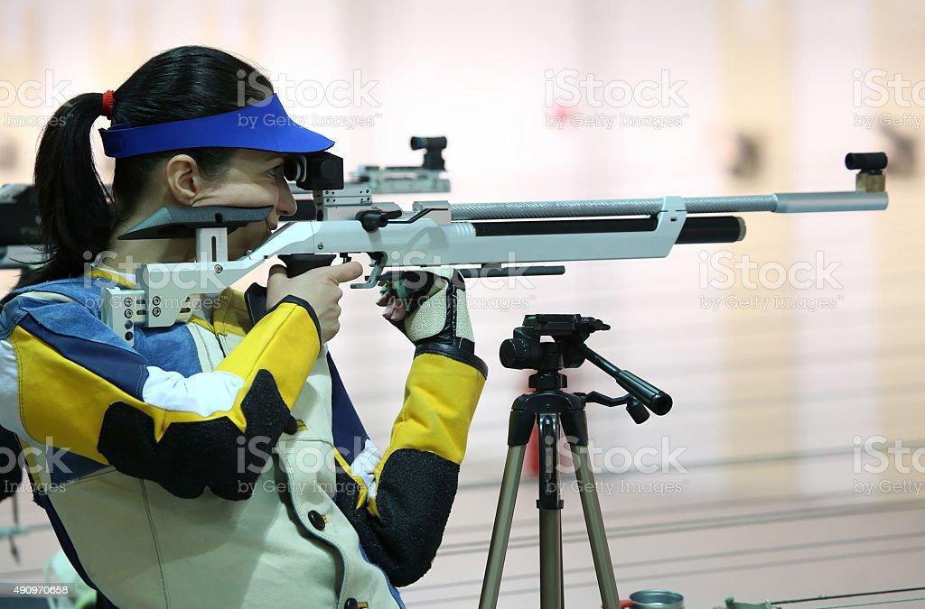 woman aiming a pneumatic air rifle stock photo