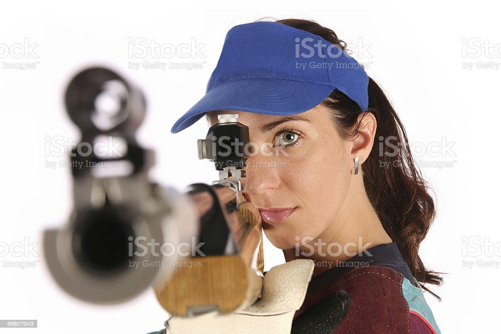 woman aiming a pneumatic air rifle royalty-free stock photo