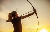 Woman Aiming In Archery