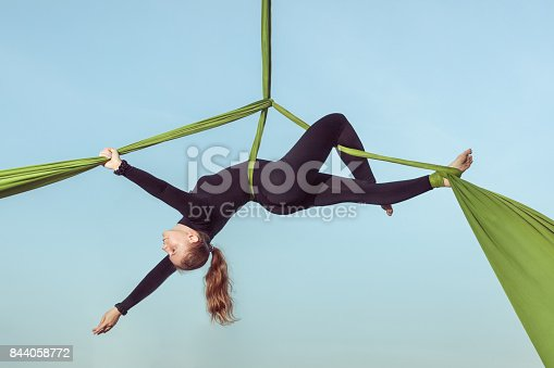 istock Woman air equilibrist. 844058772