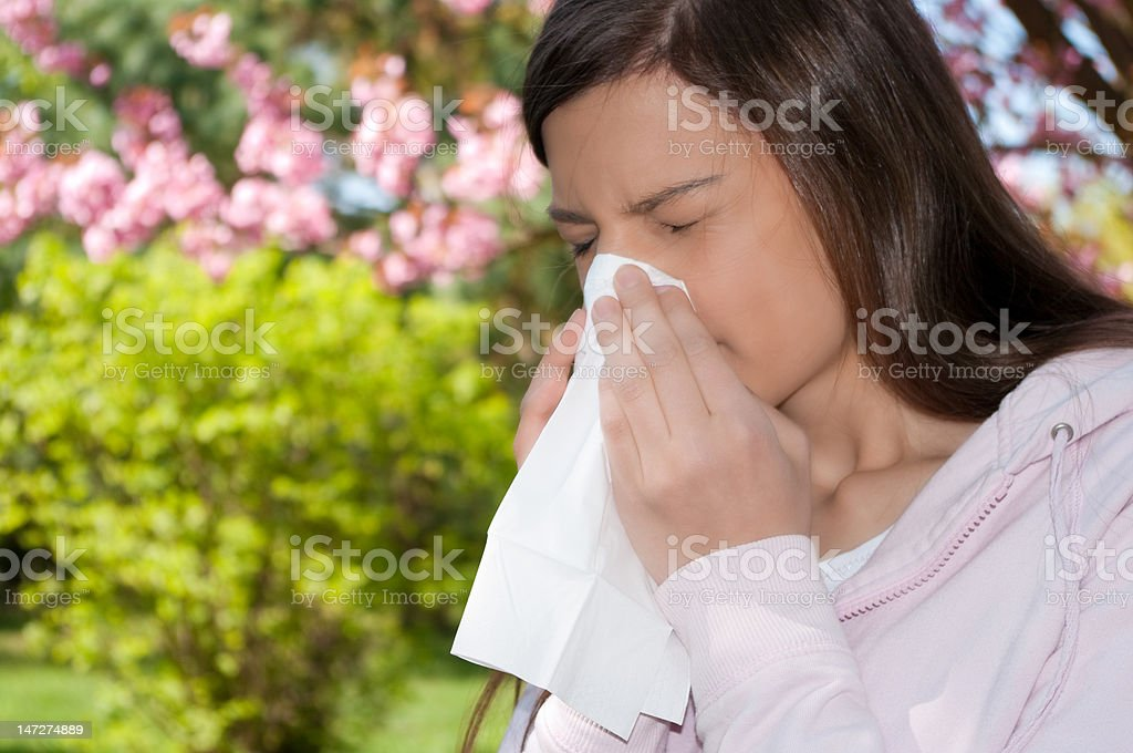 woman  allergy sneeze stock photo