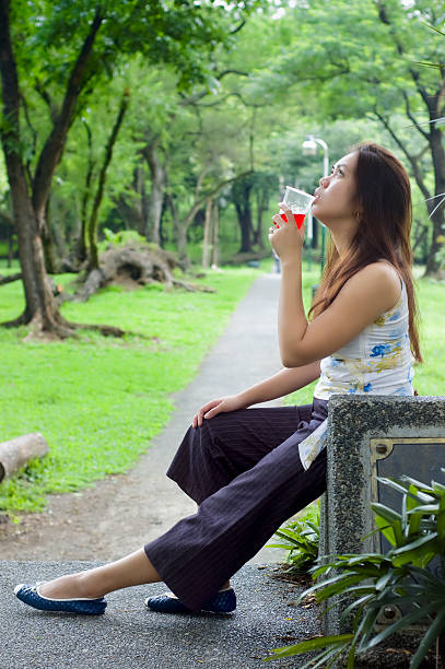 woman almost drinking - flat shoe stock photos and pictures