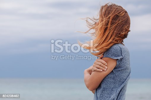istock Woman alone and depressed at seaside 824208462