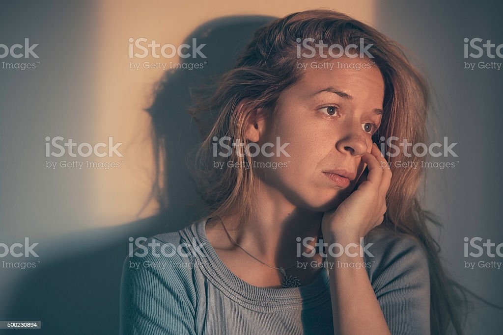 Woman alone and depressed stock photo