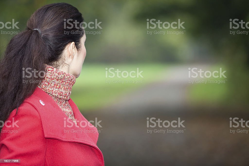 Woman alone in a park stock photo