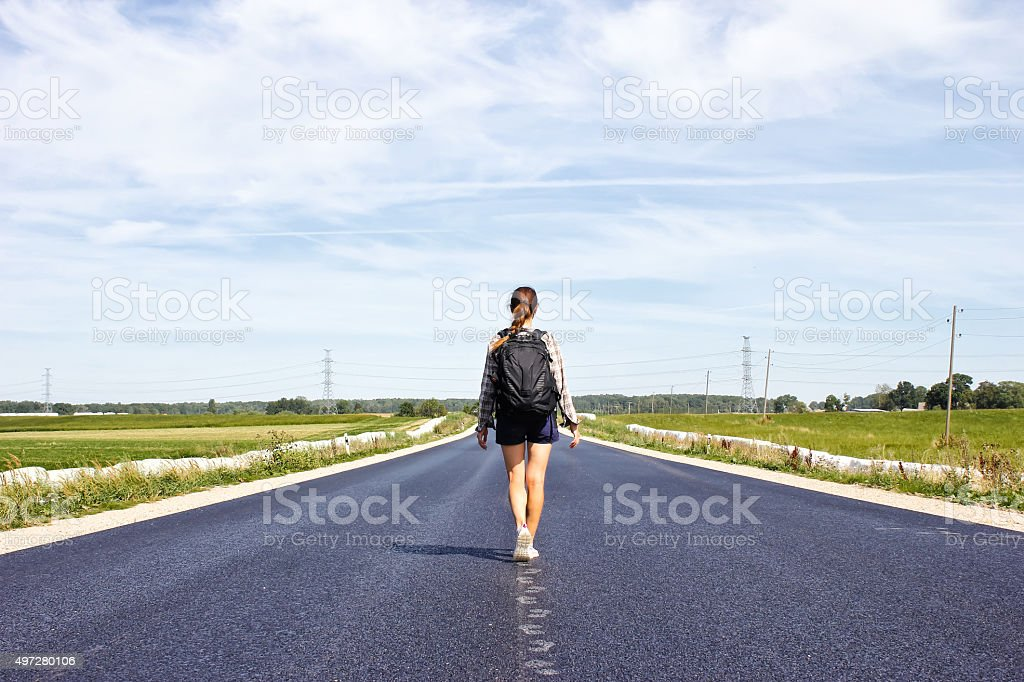 Image result for a woman standing on road