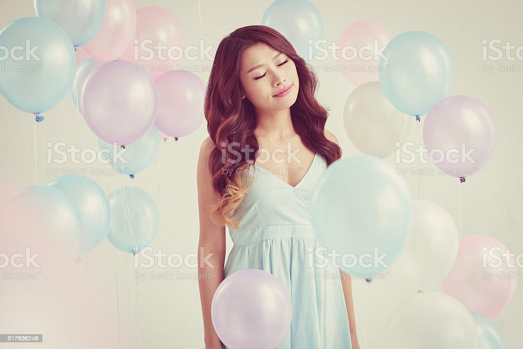 Woman among balloons stock photo