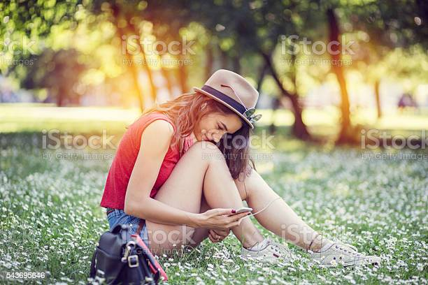 Photo of Woman among nature texting on phone
