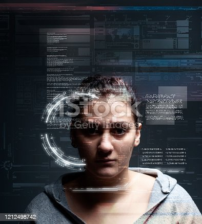 1054713428 istock photo Woman analyze futuristic user interface . High tech screens data and information . 1212498742
