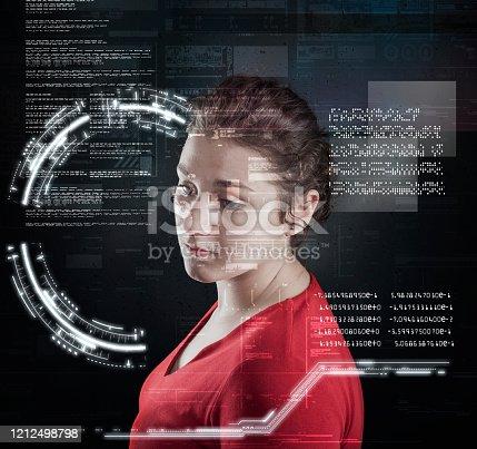 1054713428 istock photo Woman analyze futuristic user interface . High tech screens data and information . 1212498798