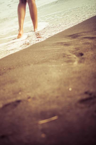女性とビーチ。 ストックフォト