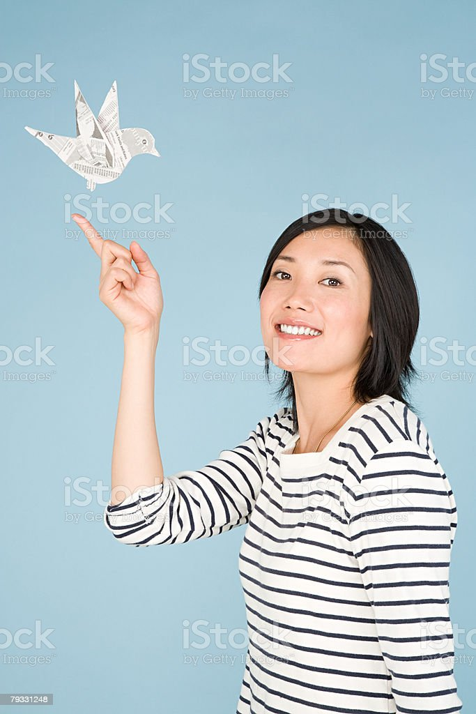 A woman and a bird made of newspaper 免版稅 stock photo