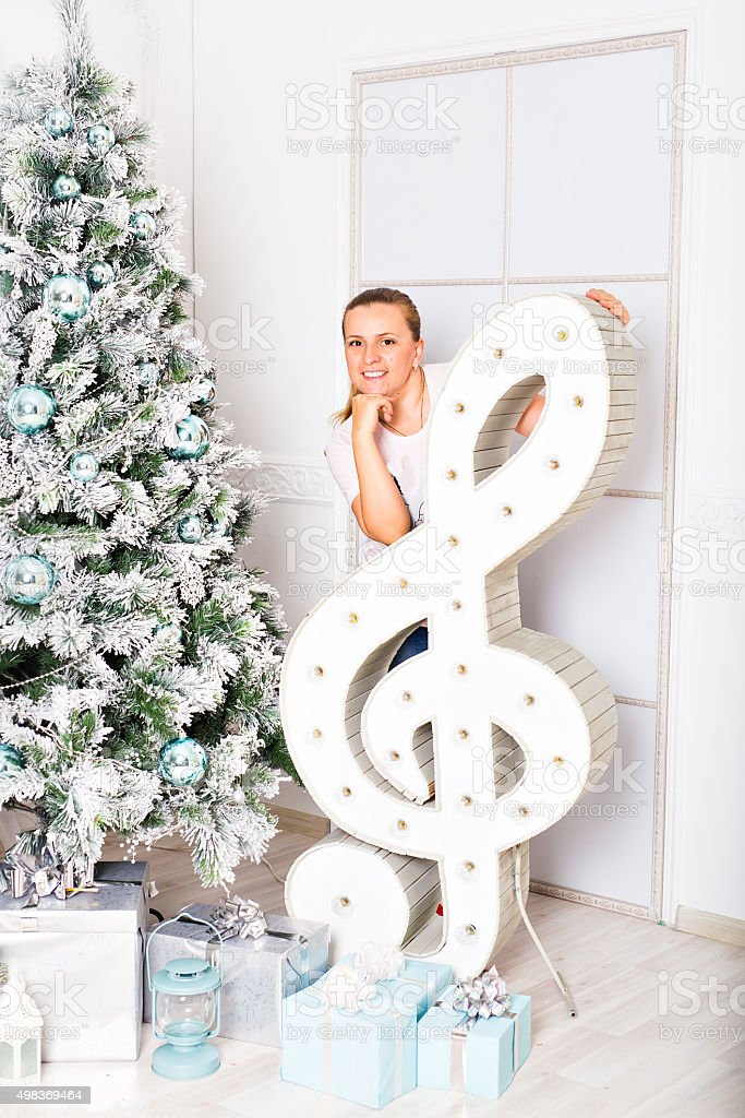 woman and a treble clef stock photo