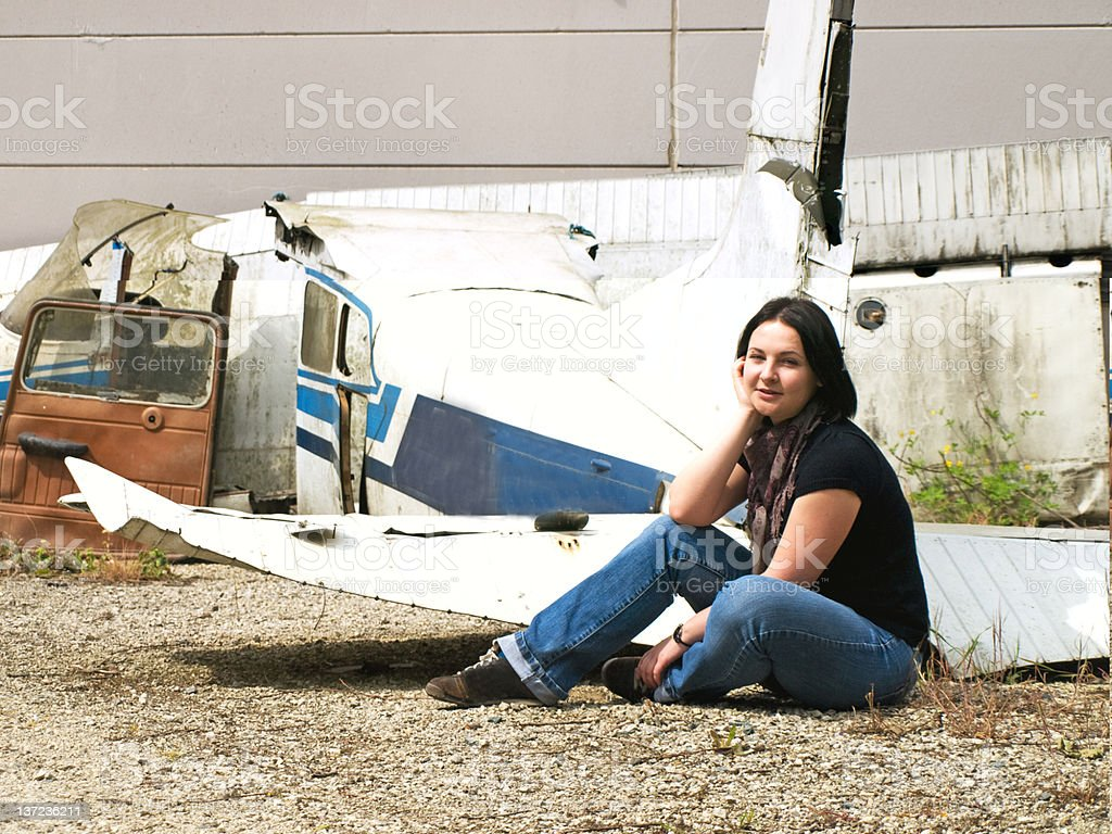 Woman and airplane royalty-free stock photo