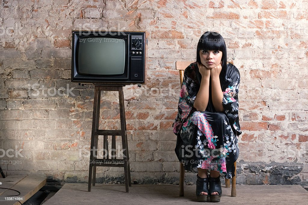 woman and an old television royalty-free stock photo