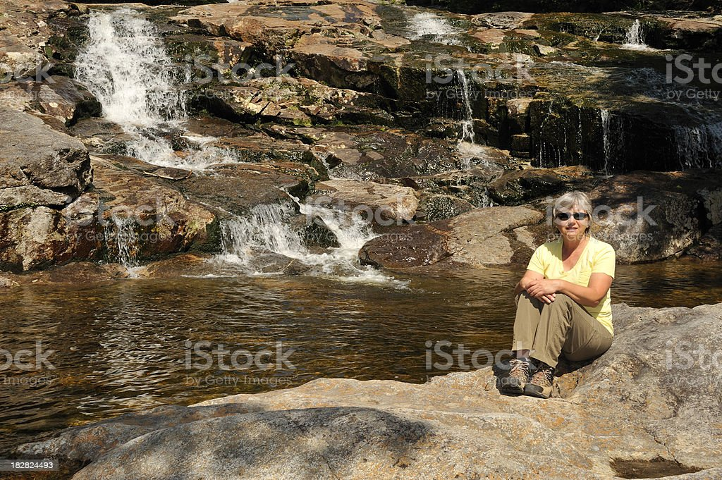Woman and beautiful waterfall, Franconia Notch State Park, New Hampshire stock photo