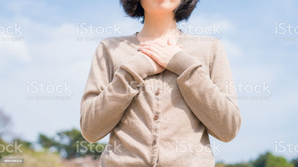Woman and blue sky stock photo