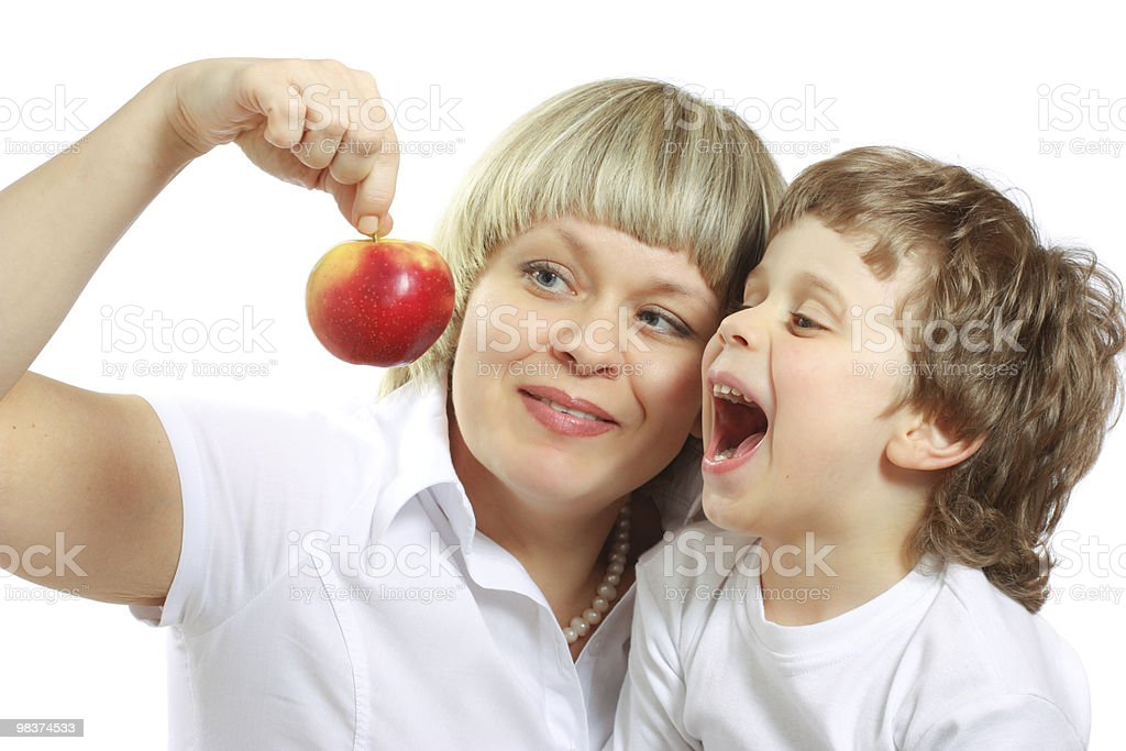 woman and boy eating apple royalty-free stock photo
