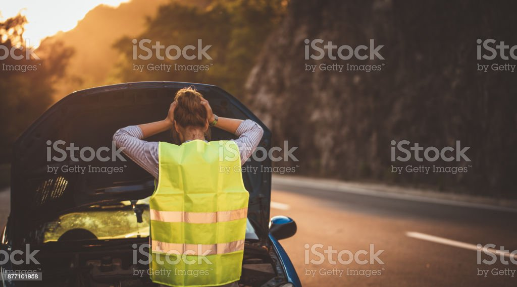Woman and broken car stock photo