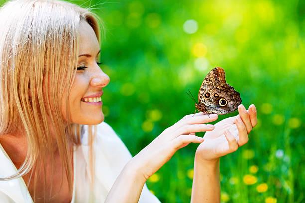 Woman and butterfly picture id499467403?b=1&k=6&m=499467403&s=612x612&w=0&h=ta39blkec5dhnt dzfsrawb0lipjlbx7p433t1lc0vs=