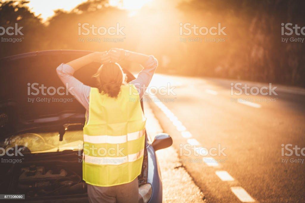 Woman and car failure stock photo