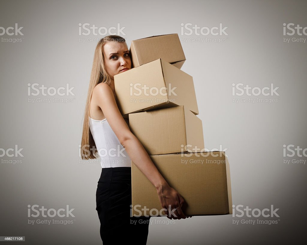Woman and cardboards. stock photo