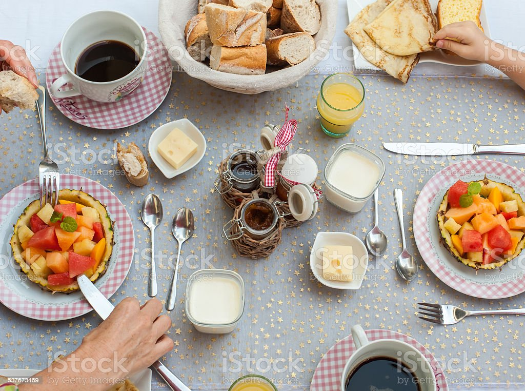 Woman and child eating breakfast stock photo