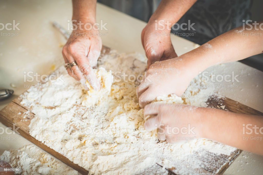 Woman and Child Making Cookies stock photo