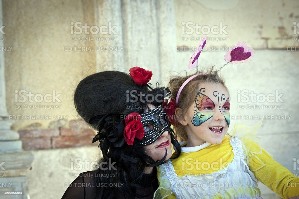 Woman and Child Masks Posing 2013 Carnival Venice Italy royalty-free stock photo