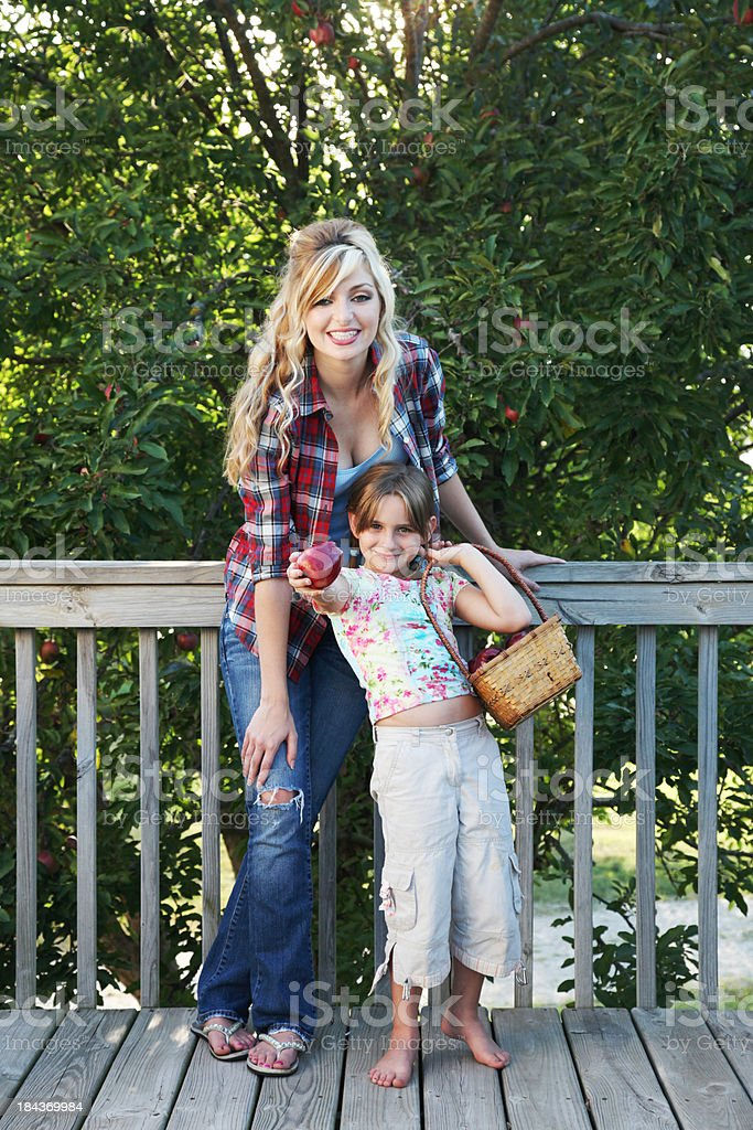 Woman and child picking apples royalty-free stock photo