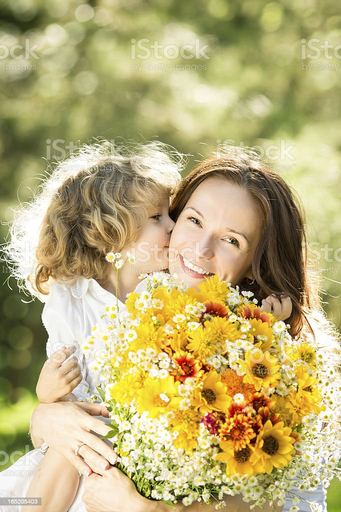 Woman and child with bouquet of flowers royalty-free stock photo