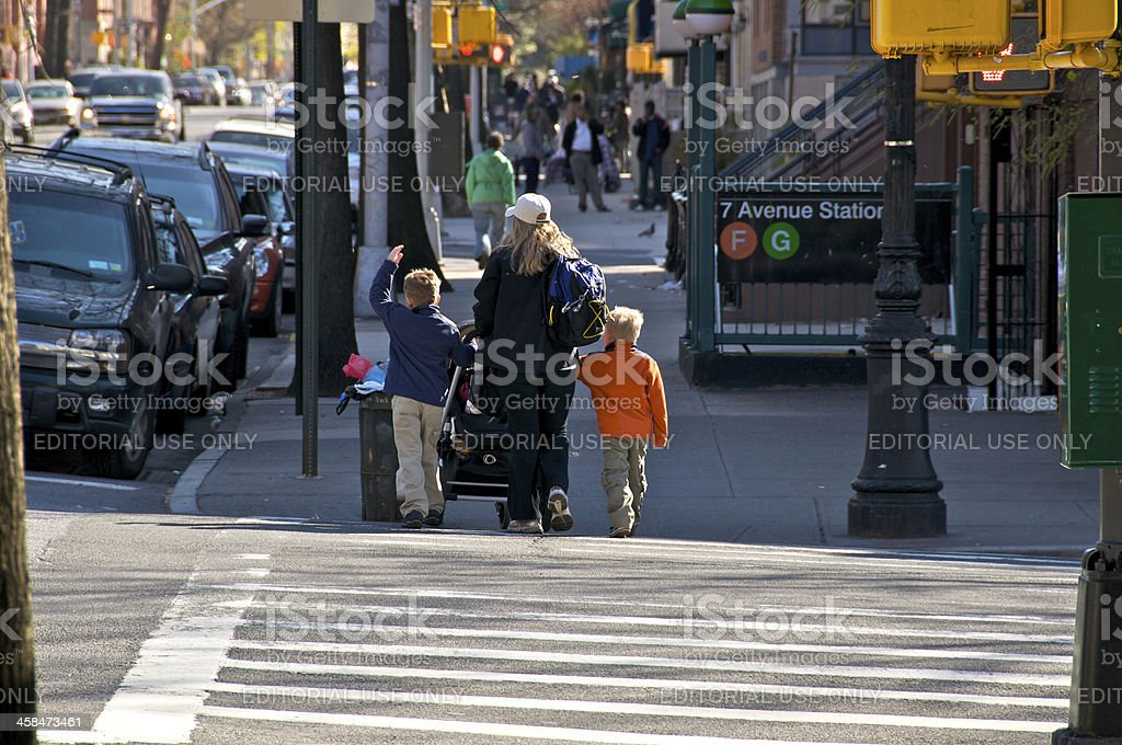 Woman and children pedestrians rush across intersection, Brooklyn, NYC stock photo