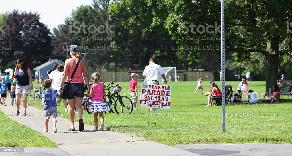 Woman and Children Walking Toward the July 4th Parade stock photo