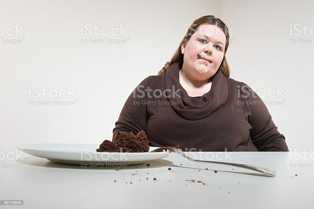 Woman and chocolate cake royalty-free stock photo